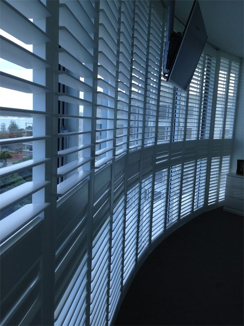 Large curve shape shutters for luxury interior room design