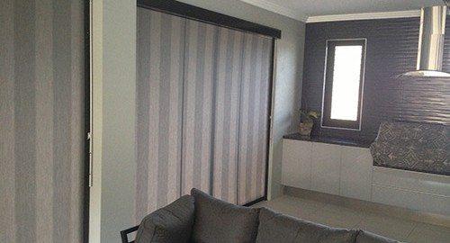 Striped awnings zip screen inside modern living room