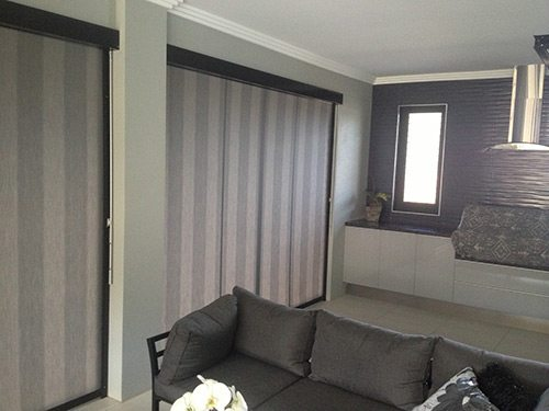 Striped awnings zip screen inside modern living room