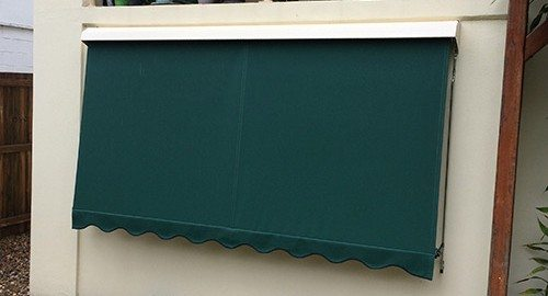 Green automatic awnings installed on a wall