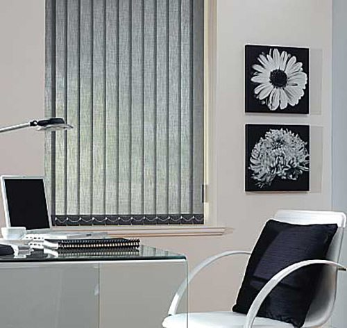 Black vertical blinds installed inside a modern office cabin