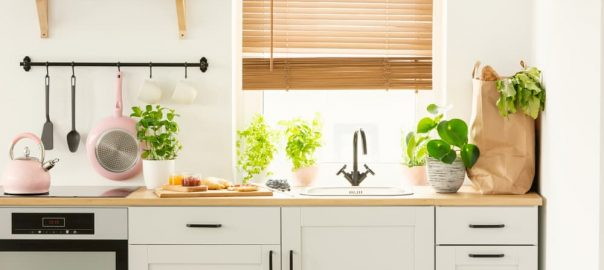 Window with blinds in a kitchen interior